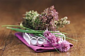Chives with flowers, bunch of herbs behind