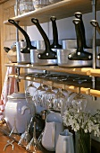 Kitchen shelf with pans and glasses