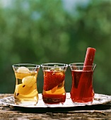 Three glasses of iced tea with fruit