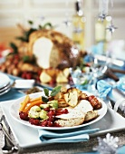 Slices of turkey breast with nut stuffing and accompaniments