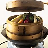 Vegetables in steaming basket