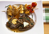 Grilled beef steaks with potato kebab