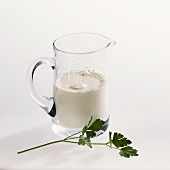 Jug of milk and parsley