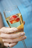 A glass of champagne with strawberry