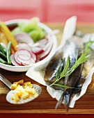 Matje herring fillet with radish and bean salad
