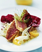 Red mullet with radicchio leaves and orange segments