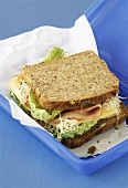 Wholemeal ham sandwich with alfalfa sprouts