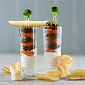 Skewered meat and apricots on yoghurt dip