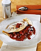 Almond pancakes with raspberry and cherry filling