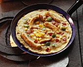 Frittata with vegetables and strips of turkey