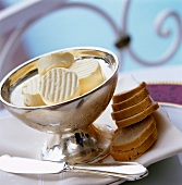 Slices of butter in silver bowl