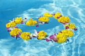 Flower wreath floating on water