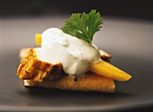 Canapé with smoked chicken breast and mango