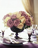 Arrangement of roses on laid table (close-up)
