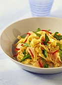 Ribbon pasta with turkey ham, rocket and chili peppers
