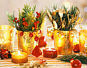 Golden glasses with false cypress and red berries