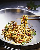 Asian noodles cooked in wok with asparagus and peppers