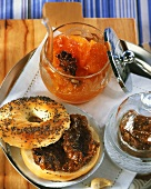 Poppy seed bagel with plum puree and apricot & tomato jam