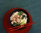 Asian noodle soup with pak choi and meatballs