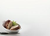 Stuffed roast pork with crackling