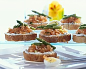 Salmon tartar crostini with green asparagus tips & quail's eggs