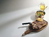 T-bone steak with rosti and vegetables