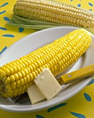 Corncobs with butter