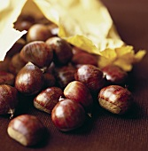 Sweet chestnuts falling out of paper bag