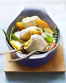 Stuffed fish rolls with apple wedges and mangetout peas