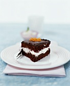 A piece of chocolate cream cake