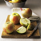 Apples, whole and cut open (Cox's orange pippin)