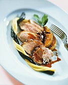 Duck breast with Cassis pear and black and white spaghetti