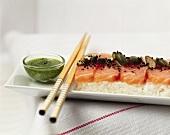 Salmon sashimi with coriander pesto