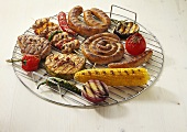 Various barbecue foods on grill rack