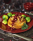 Vegetarian filled puff pastry with cranberry sauce