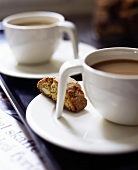 Two cups of coffee with cantucci