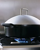 Pan with lid on gas cooker