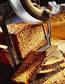 Slicing wholemeal bread with old bread slicer