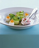 Quails' eggs with salmon caviare, courgette rolls & radish dip