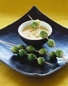 Creamed potato soup with skewered Brussels sprouts