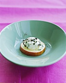 Fresh goat's cheese with marjoram on apple slice