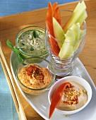 Strips of vegetables with peanut dip, cheese dip & herb dip