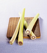 Fresh lemon grass stalks on a kitchen board