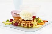 Waffles with honey, fruit and vanilla ice cream
