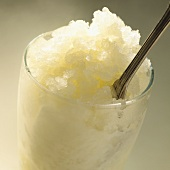 Champagne granita with a spoon in a glass