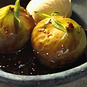 Fresh figs in syrup with vanilla ice cream