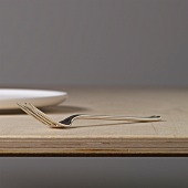 Silver fork on a wooden board