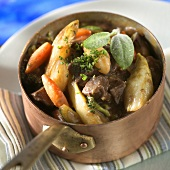 Vegetable stew with meat in copper pan