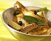 Chicken legs with fried baby corncobs