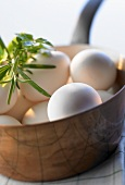 White eggs in a copper pan, close-up